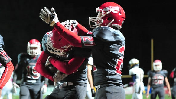 Erwin football players celebrate a touchdown in Friday's