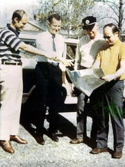 From left, Bill McIntyre, Buddy Dye, Boney Wray and C.K. Polly check out a map as they plan for the Charlie Browners' first golf trip in 1970, which was to Myrtle Beach, S.C.