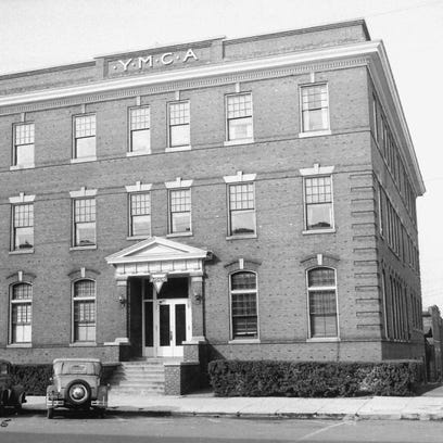 The old YMCA building at the southwest corner of Third and Main streets (now a parking lot) in 1945. The Henderson Young Men's Christian Association was organized in 1894, and initially met in various churches and downtown buildings. The Main Street facility was constructed in approximately 1907, providing a gym, swimming pool, bowling alley, pool tables, reading and meeting rooms, space for Bible classes and a dormitory for young men away from home. In 1916, an agreement was reached to allow women and girls access to the gym and poool on certain days.(Photo courtesy of Carole Summers)