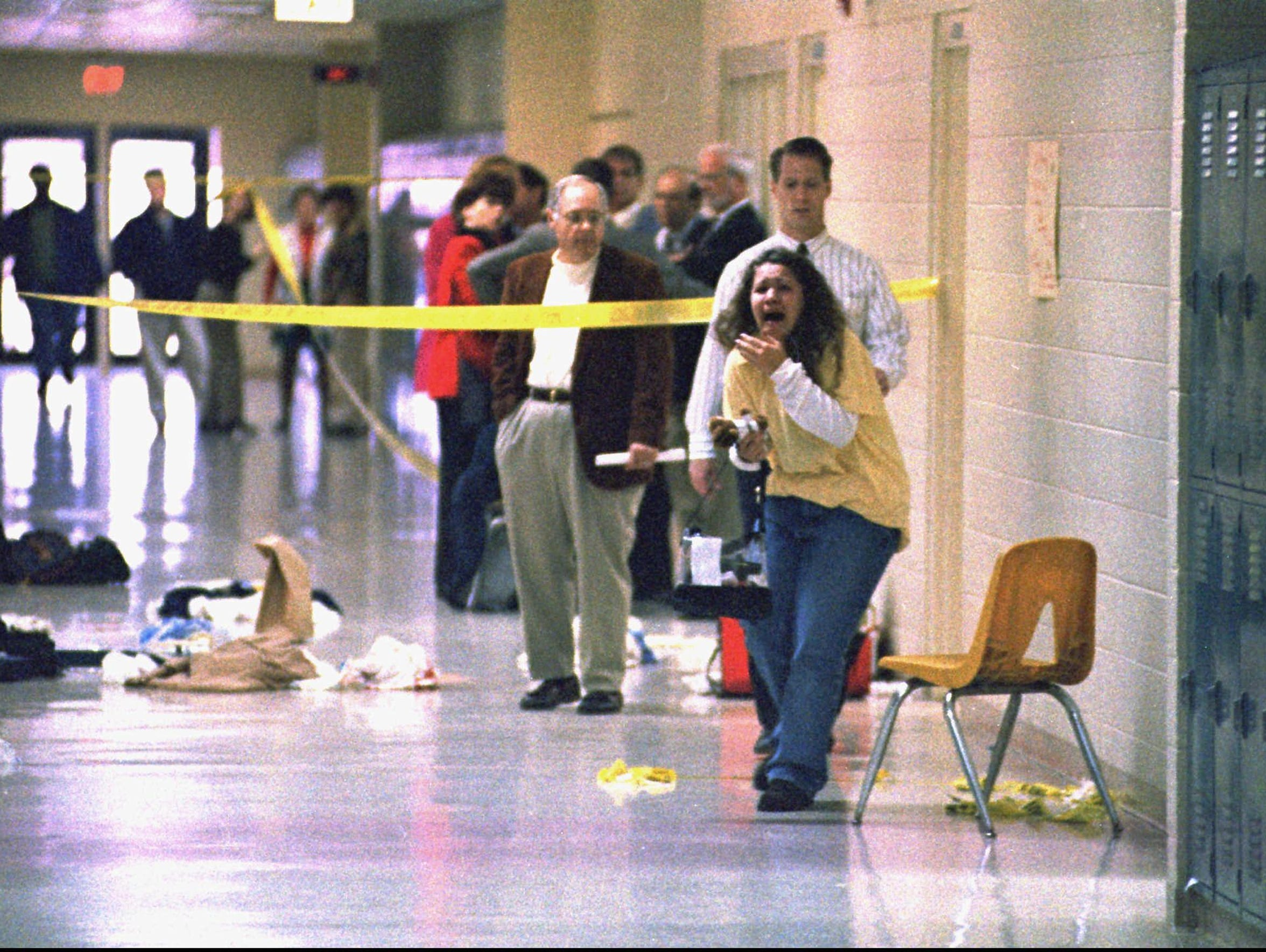 A student screams at the Heath High School shooting scene on Dec. 1, 1997, during which three students were killed. Hollan Holm was among the five students injured. Holm, then a 14-year-old, said he stills deals daily with the effects of having survived a school shooting. Holm tells his story in the final episode of the podcast Aftermath, produced by USA Today in collaboration with The Trace. (File)