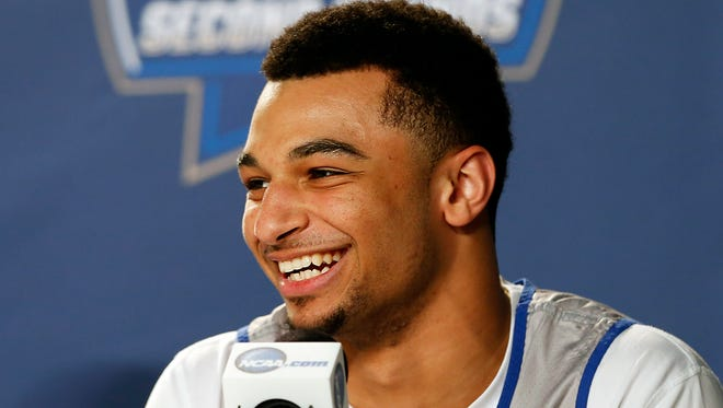 Kentucky's Jamal Murray laughs at the press conference when asked about his bow and arrow. Marc. 16, 2016