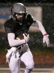 West Salem's Noah Whitaker (20) runs with the ball