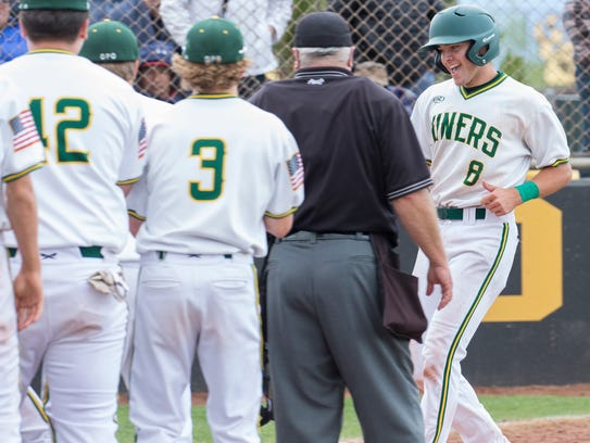 Manogue's CJ Hires is congratulated by teammates after