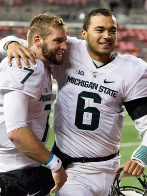 Michigan State Spartans quarterbacks Tyler O'Connor (7) and Damion Terry (6) celebrate after leading MSU past Ohio State on Nov. 21 in Columbus in Connor Cook's absence. O'Connor and Terry will via for the starting job next season.
