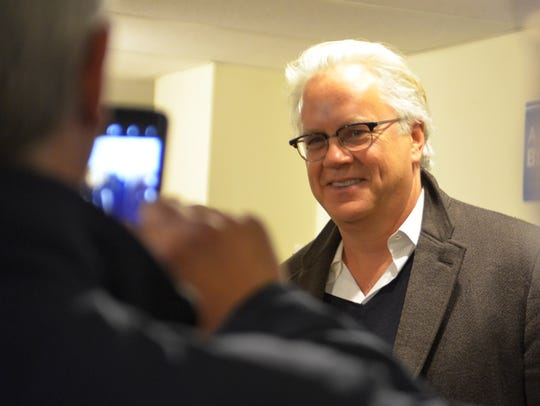 Actor Tim Robbins poses for a photo Monday while visiting