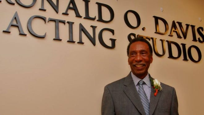 Ronald Davis stands in front of the acting studio that was named for him.