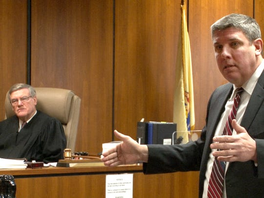 Senior Assistant Ocean County Prosecutor Michael Weatherstone delivers his opening statement during the trial of Alan Bienkowski in Superior Court Judge James M. Blaney's courtroom in Toms River Tuesday, January 26, 2016.   Bienkowski is charged with the murder of his 76-year-old neighbor, Anthony Verdicchio, in Manchester Township.