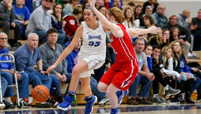 Hamilton Southeastern's Sydney Parrish (33) tries to get past Plainfield's Samantha Olinger during Thursday's girls basketball game.