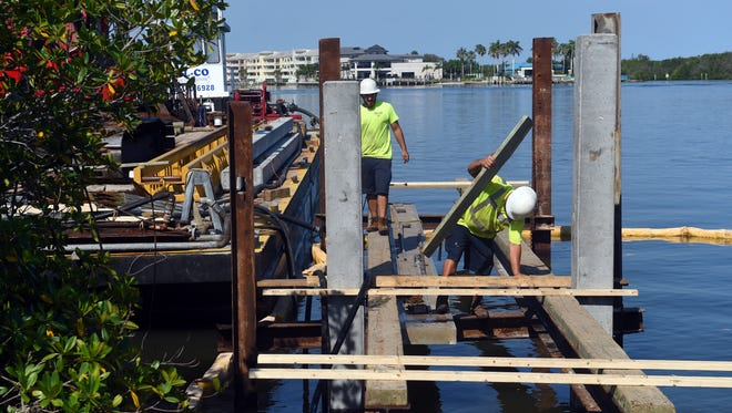 Construction workers begin laying the foundation for the Cole Coppola Memorial Fishing Pier at Riverside Park Friday, May 11, 2018, in Vero Beach. The 1,200-square-foot pier is a joint project between the Live Like Cole Foundation, The City of Vero Beach and the Florida Inland Navigational District. Members of the community will have the opportunity to place their name or customized message on the project by purchasing treads that make up the pier. The pier is being built in memory of Cole Coppola, a local teenager who was hit by a car killed while riding his bike on 17th Street across the Alma Lee Loy Bridge in 2014.