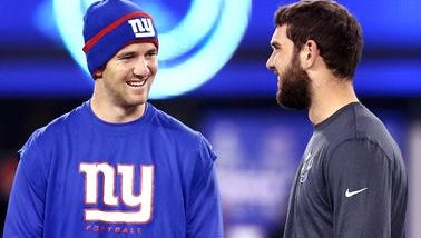 New York Giants quarterback Eli Manning and Colts quarterback Andrew Luck take a moment to chat at mid-field as both teams prepare for the start of Monday Night Football at MetLife Stadium in East Rutherford, NJ  on Nov. 3.