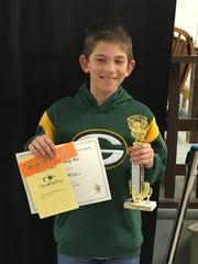 Mishicot middle-schooler Kaden Kowalski shows his award