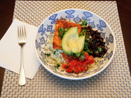 The mojo salmon and cauliflower rice bowl, a recipe created by local dietitian Anna Jones consists of many healthy ingredients and packs a powerful flavor.