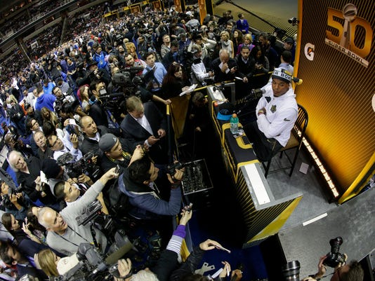 Carolina Panthers quarterback Cam Newton speaks to reporters during Opening Night for the NFL Super Bowl 50 football game Monday, Feb. 1, 2016, in San Jose, Calif. (AP Photo/Charlie Riedel)