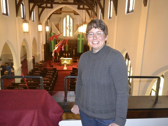 Pastor Rachel Knoke stands in the balcony of the sanctuary