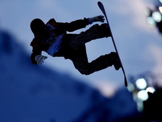 Ilkka-Eemeli Laari (FIN) competes during the second run of the men's halfpipe snowboarding qualification.