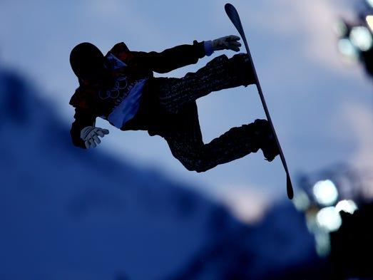 Ilkka-Eemeli Laari (FIN) competes during the second run of the men's halfpipe snowboarding qualification.
