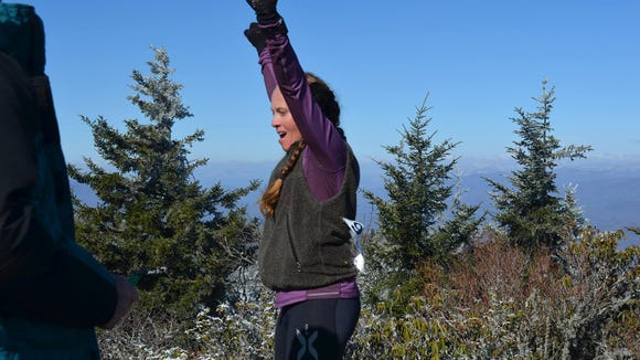 A participant in last year's Assault on BlackRock Trail Race celebrates reaching the summit. The 7-mile race is March 19 in Sylva, N.C.