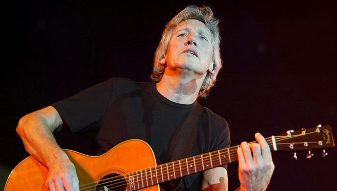 Roger Waters plays the guitar during a May 11, 2002, concert at the Hallenstadion in Zurich, Switzerland.