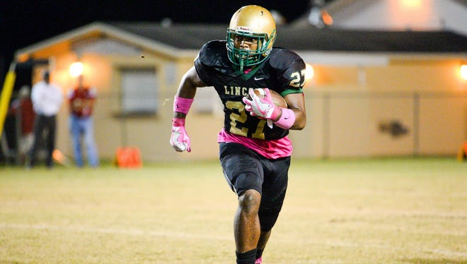 Lorenzo Geathers Jr.. runs the ball for Lincoln during a game last season.
