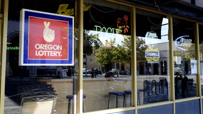 A Oregon Lottery sign hangs in the window of The Brick Bar & Broiler in downtown Salem on Thursday, Oct. 9, 2014.