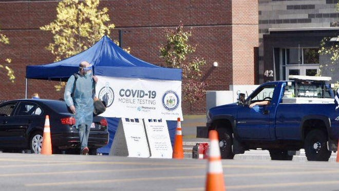 Students and staff of Sanford High School and Sanford Regional Technical Center undergo free COVID-19 testing Friday, Sept. 25, 2020, in the student parking lot. The Maine Center for Disease Control and Prevention opened an outbreak investigation at the school, where school officials have reported 18 cases.