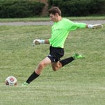 Lutheran Westland keeper Ryan Webb sends  a goal kick toward the opposite end of the pitch.