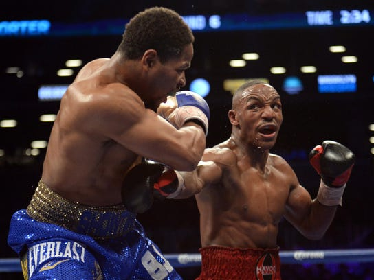 Dec 7, 2013; Brooklyn, NY, USA; Devon Alexander (black trunks) and Shawn Porter (blue trunks) box during their IBF Welterweight Title bout at Barclays Center. Mandatory Credit: Joe Camporeale-USA TODAY Sports