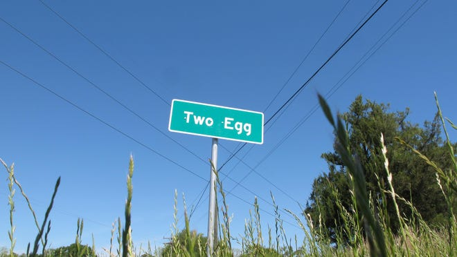A sign welcomes motorists to the town of Two Egg, Florida. Located about 70 miles northwest of Tallahasee, Florida, Two Egg is a small farming community where people used to trade eggs for goods.