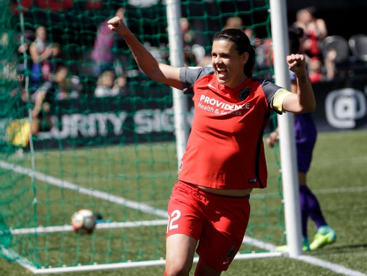 FILE - In this Saturday, April 15, 2017, file photo, Portland Thorns forward Christine Sinclair celebrates scoring a goal during the second half of their NWSL soccer match against the Orlando Pride in Portland, Ore. Sinclair and the Thorns opened up the National Women's Soccer League season last week with a victory over the Orlando Pride.  (AP Photo/Don Ryan, File)