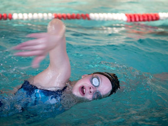 Emma Swisher swims during the second annual White Shark 100x100 Swim Challenge on Wednesday at the Bucyrus YMCA. The challenge is for swimmers to continuously swim until they have completed 100 100-yard laps, which is 5.68 miles.