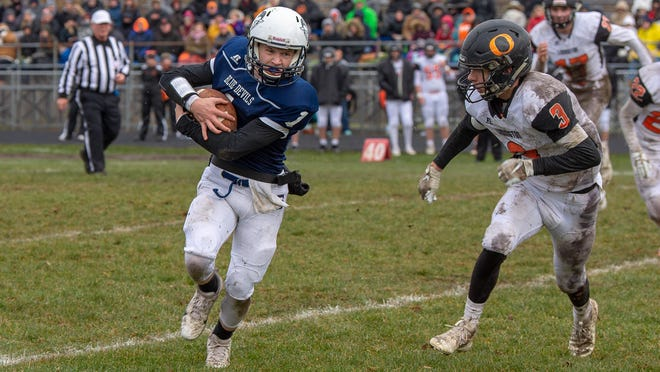 Sault High quarterback Jake Davie keeps the ball on a rollout run in a 2019 playoff game against Ludington at VanCitters Field. The Blue Devils' 2020 fall season has been postponed due to coronavirus.