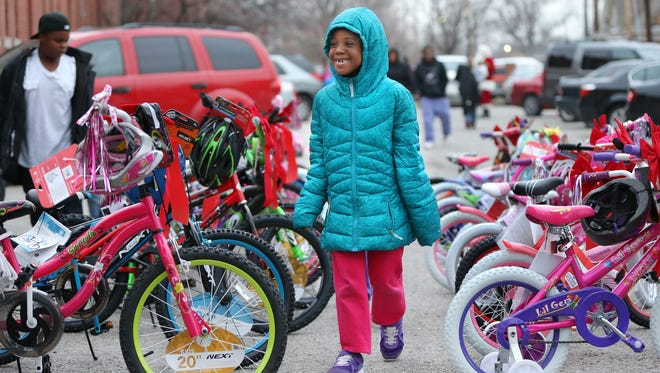 Aaliyah McCray is excited as she walks through a sea of new bicycles to find the one with her name on it at Dayspring Center. A local realtor donated the bikes for kids who stayed at the shelter for homeless families. The shelter invites supporters to donate this year on #GivingTuesday.