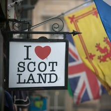 EDINBURGH, SCOTLAND - SEPTEMBER 19:  The Saltire flag flies next to the Royal Standard of Scotland and the Union Flag above a gift shop in central Edinburgh on September 19, 2014 in Edinburgh, Scotland. The majority of Scottish people have today voted 'No' in the referendum and Scotland will remain within the historic union of countries that make up the United Kingdom. (Photo by Matt Cardy/Getty Images)