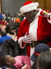 Santa (Robert Boyd) stops by the Salvation Army's Christmas