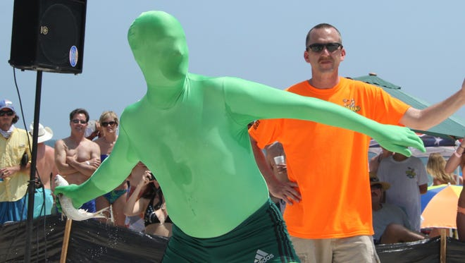 Brian Warren of Birmingham, Ala., wears a green morph suit while competing in lasy year's Mullet Toss.