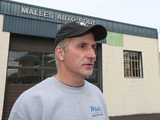 Dennis Malles, owner of Malles Auto Body in Montrose