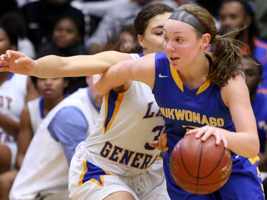 Mukwonago's Grace Beyer drives around Milwaukee King's Denise Brown for control of the ball during the Fresh Coast Basketball Classic at the UW-Milwaukee Klotsche Center on Nov. 24, 2017.