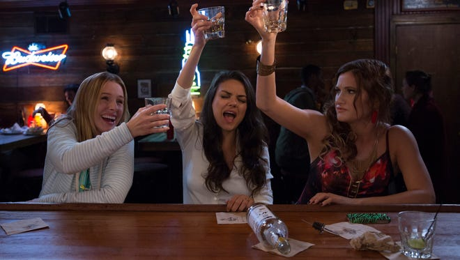 Kristen Bell (left), Mila Kunis and Kathryn Hahn throw it back in 'Bad Moms.'