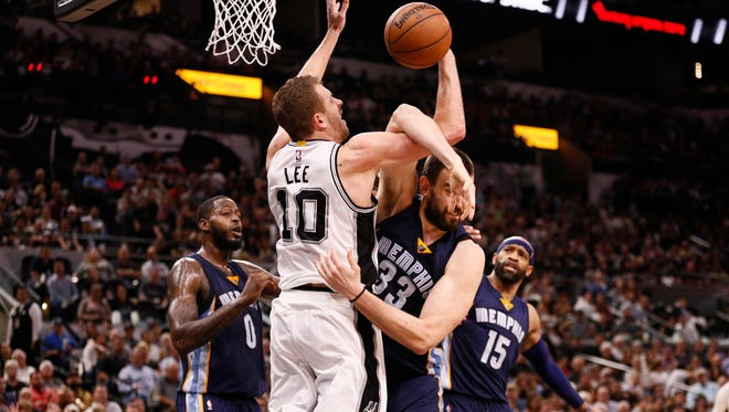 San Antonio Spurs power forward David Lee (10) and Memphis Grizzlies center Marc Gasol (33) battle for a rebound during the second half of Game 5 in a first-round series on April 25, 2017.