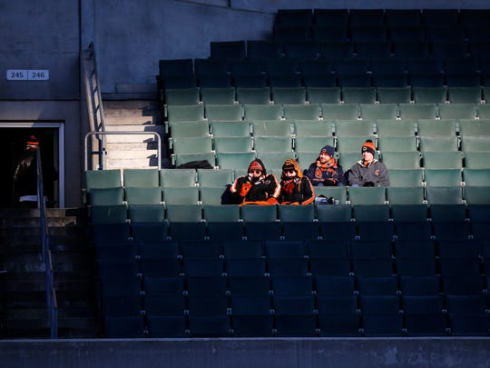 Two pairs of Cincinnati Bengals and Chicago Bears fans remain in section 246 late in the fourth quarter of the NFL Week 14 game between the Cincinnati Bengals and the Chicago Bears at Paul Brown Stadium in downtown Cincinnati on Sunday, Dec. 10, 2017. The Bengals fall to 5-8 with a 33-7 loss to the Bears.