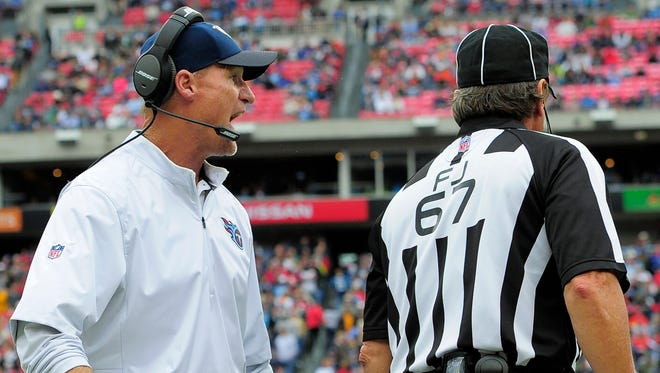 Titans coach Ken Whisenhunt yells at field judge Doug Rosenbaum after officials failed throw a flag when quarterback Zach Mettenberger was hit in the face by a Falcons defender during the second quarter.