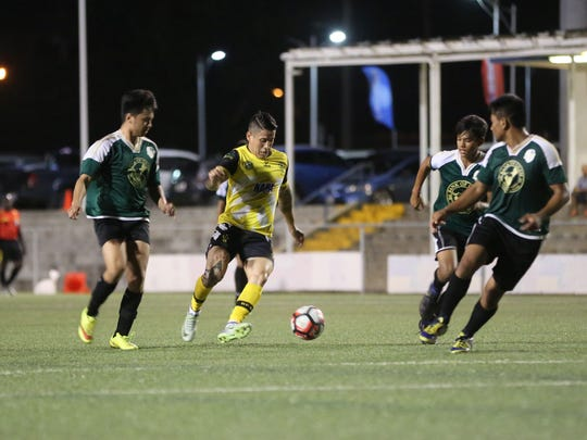 NAPA Rovers' Jonahan Romero maneuvers through the Bank of Guam Strykers D2 defense in a Round 1 match of the Bank of Guam 10th Annual GFA Cup men's soccer tournament Tuesday May 2, 2017, at the Guam Football Association National Training Center. The Rovers won 9-1.