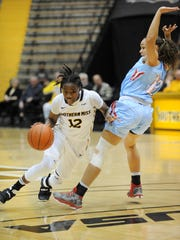 Southern Miss'  Brittanny Dinkins drives past a defender