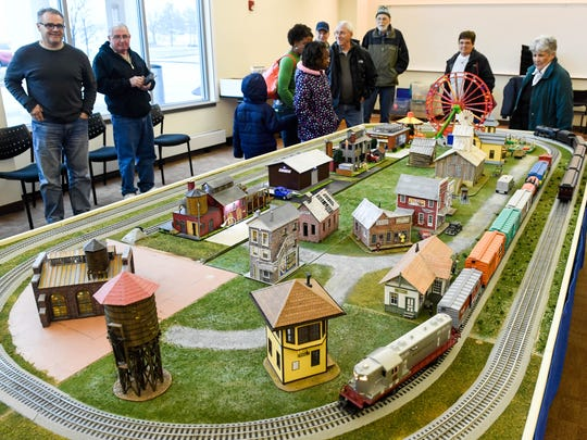 Visitors at the Ohio Township Central Library enjoy the Local Loco Model Railroad Club show held at the library Saturday and Sunday, January 15, 2017.