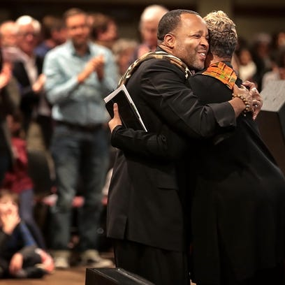 New Direction Pastor Stacy Spencer (left) embraces
