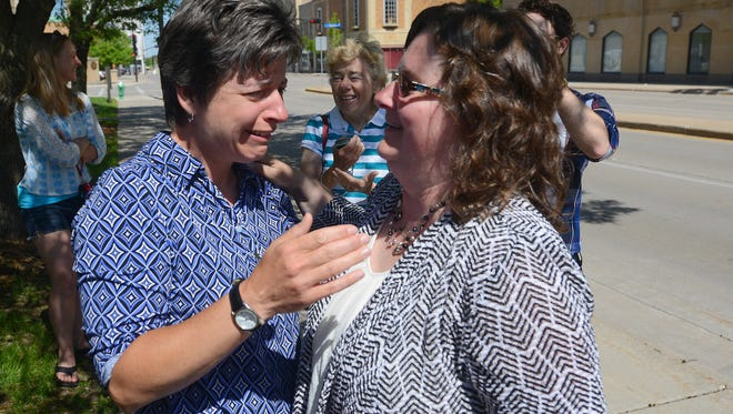 Stacie Christian, right, and Julie Tetzlaff celebrate their marriage in Green Bay after the Brown County Clerk's office began issuing marriage licenses to same-sex couples. The couple has been together for 21 years.