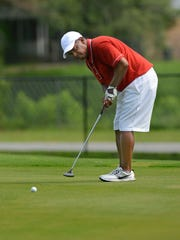 Carl Palmer putts on the 7th green Sunday, June 25,
