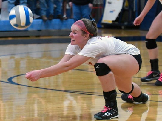 St. Philip's Kirstin Finnila (11) lunges for the ball