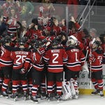 New Jersey Devils mob teammate Kyle Palmieri after he scored the winning goal in overtime of an NHL hockey game against the Vancouver Canucks, Sunday, Nov. 8, 2015, Newark, N.J. The Devils won in overtime 4-3. (AP Photo/Mel Evans)