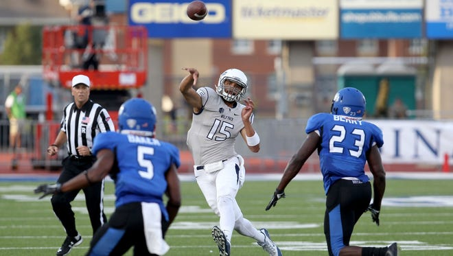 Tyler Stewart throws on the run during a win over Buffalo last season.